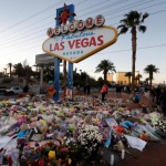Las Vegas Shooting Route 91 Harvest Festival Investigation closed sign flowers