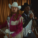Lil Nas X and Billy Ray Cyrus in the Old Town Road video watch