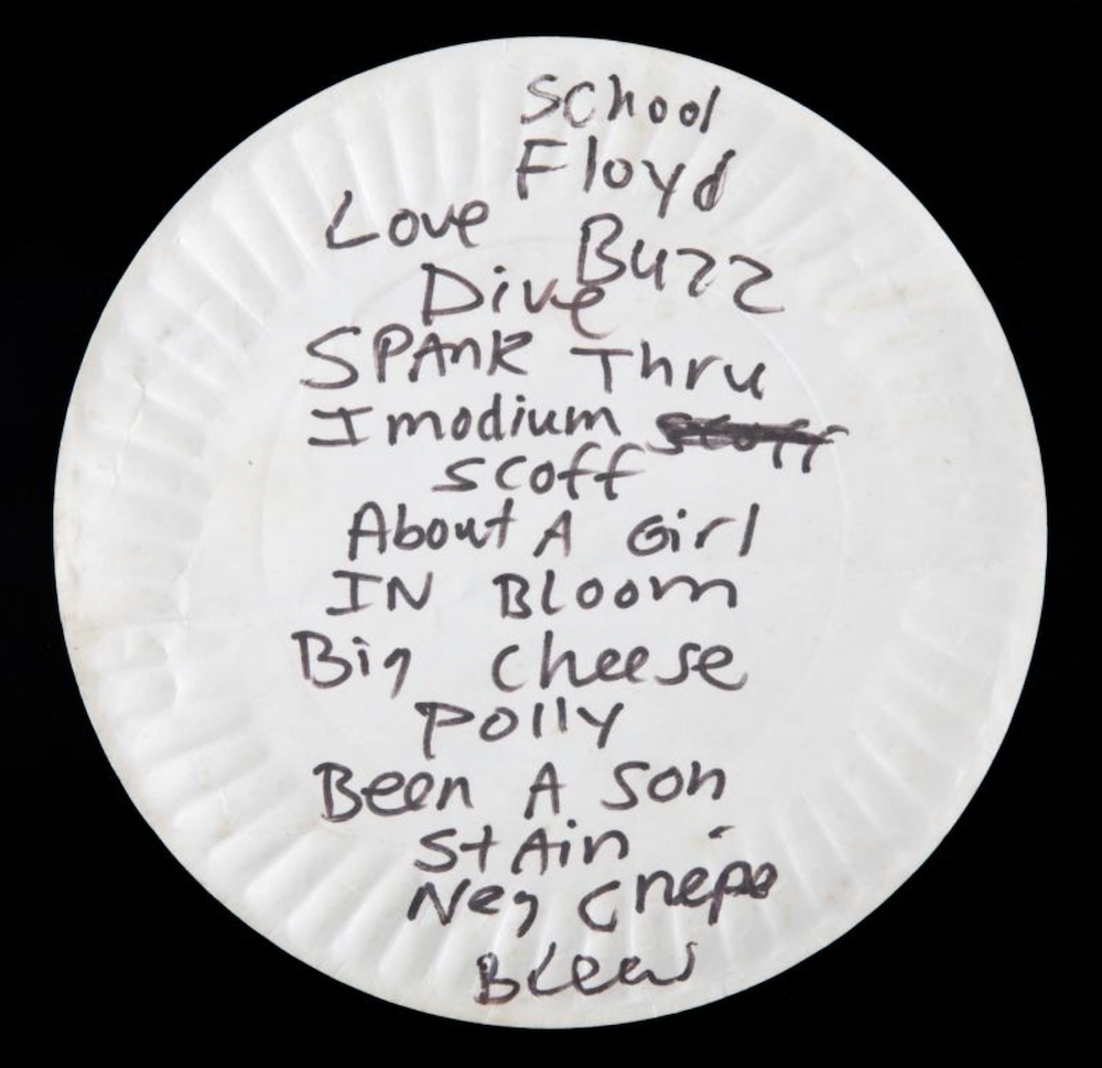 kurt cobain pizza plate setlist auction Used Kurt Cobain paper pizza plate sells for $23,000