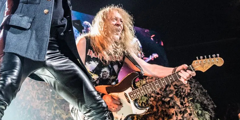 Iron Maiden's Janick Gers flings guitar into crowd