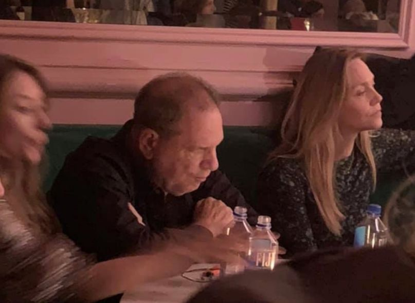Harvey Weinstein being heckled at NYC bar, photo via Zoe Stuckless