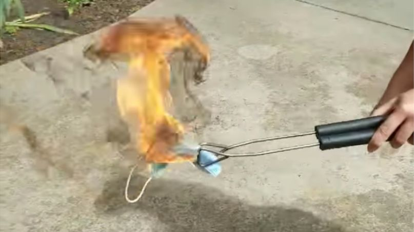 Donald Trump burning face masks voters (ReOpen NC / Facebook)