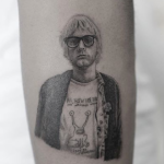 Kid Cudi's Kurt Cobain / Daniel Johnston tattoo
