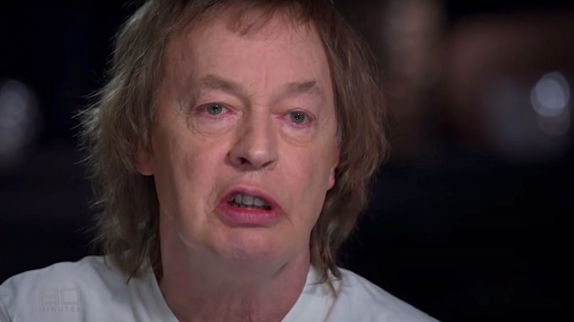 Angus Young tears up about Malcolm