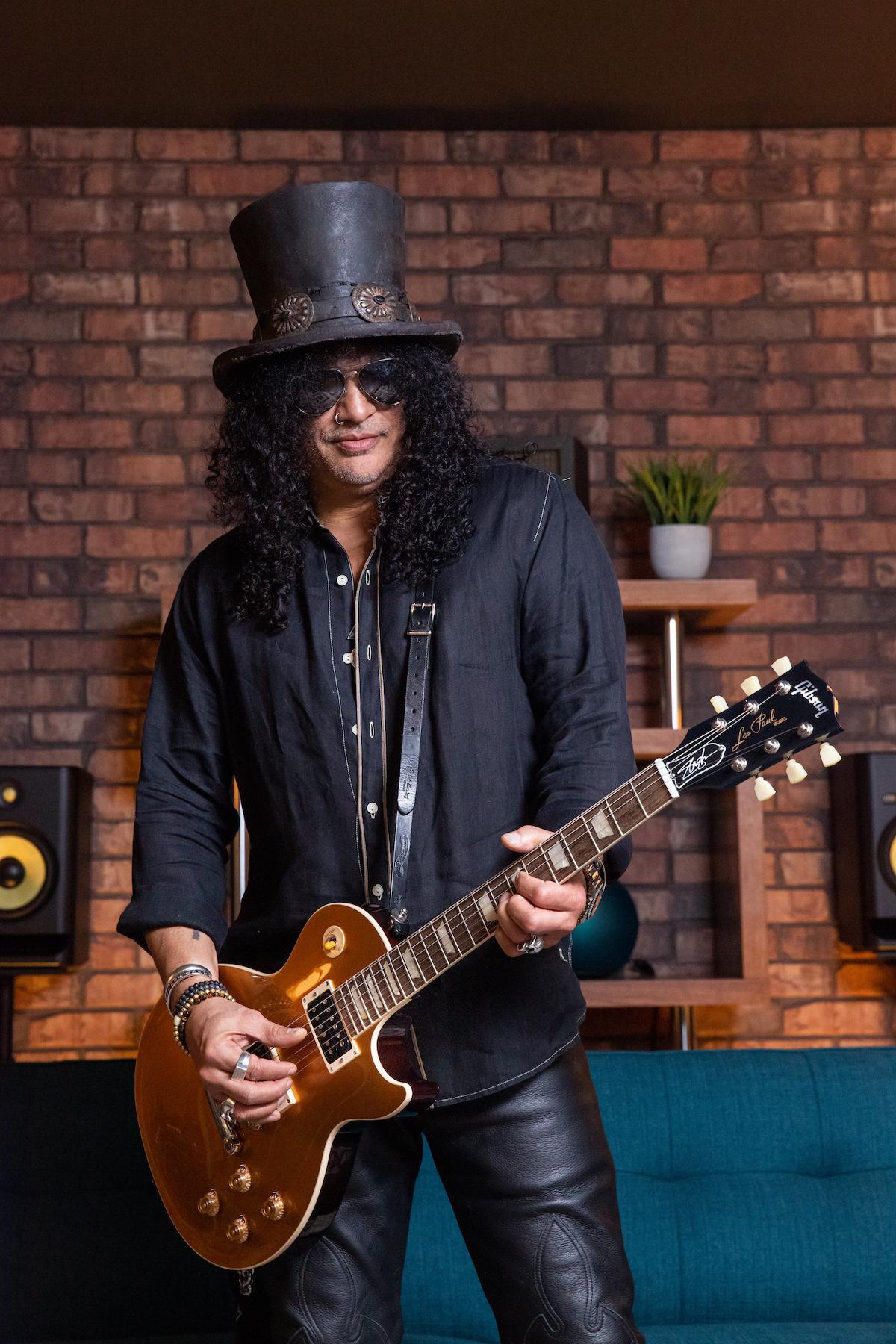 Slash Goldtop tall Slash Unveils Gibson Victoria Les Paul Standard Goldtop Electric Guitar